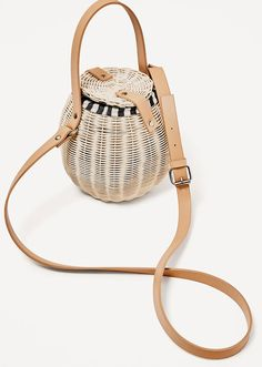 Top Handbag Trends Spring 2017 | The Basket Bag | Zara Raffia Bucket Bag, $59.90; at Zara
