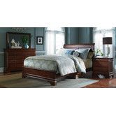 Found it at Wayfair - Chateau Royal Sleigh Bedroom Collection - looks like it would match our current furniture!!!