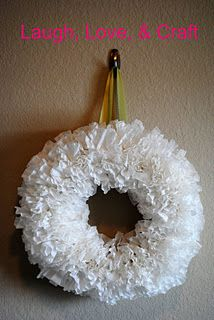 Coffee Filter Wreath. I made one last night and I'm so in love with it. I have plans to make 2 more for my house and 2 more for gifts! Dollar Store coffee filters, Dollar Store wreath form, Dollar Store ribbon. Oh yeah, $3 gifts! Can't beat it!