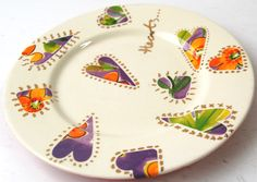 One of our plates has been decorated using decals and Gold overglaze.  Very pretty.