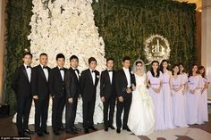 Angelababy and her actor husband Huang Xiaoming pictured with their bridesmaids and groomsmen at their wedding in Shanghai