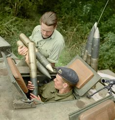 Load of 75mm ammunition into the turret of a Churchill tank in Normandy. 17th of July 1944.