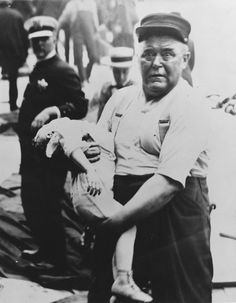 Chicago fireman Leonard E. Olson carrying a child from the Eastland Disaster. He received the Lambert Tree Medal for his heroic deeds. Photograph by Jun Fujita.