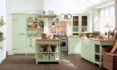 landhausküche hellgrüne küchenmöbel kücheninsel aufbewahrungskörbe wanddeko
