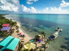 """X'tan Ha """"The Waterfront"""" Resort is a secluded getaway 7.2 miles north of San Pedro on a stretch of pristine white sandy beach with beautiful turquoise water."""