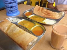 What people have for breakfast in Singapore - Indian vegetarian goodie Thosai Masala and Teh Halia (Ginger Milk Tea)