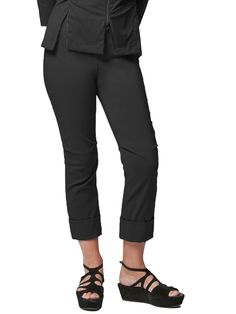 Sleek, urban cropped pant references the business suit with feminine style. Turn-up cuffed hem is stitched to stay neat. Top-stitched seam at the back knee releases into a stitched pleat for movement. New, rib elastic waist creates a fitted look with stretch. Invisible front zipper allows easy dressing. Made in the U.S.A. New Vespa, Feminine Style, Simple Dresses, Cropped Pants, Elastic Waist, Capri Pants, Dressing, Urban, Zipper