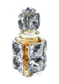 Caron - I've seen this in person at The Perfume House in Portland. Crystals and diamond dust.