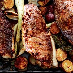 This two-technique solution—baking first, then finishing under the broiler—yields perfectly browned fish and tender vegetables.
