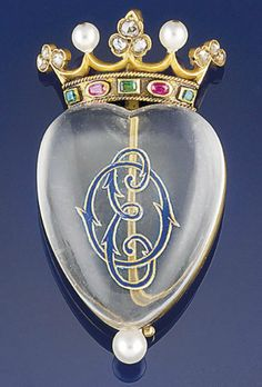 "An antique rock crystal and gem-set brooch. The heart-shaped rock crystal cabochon with reverse painted monogram ""EO"" to the rose-cut diamond, ruby and emerald coronet surmount with pearl detail, circa 1880, in fitted purple velvet case by Henry Tessier."