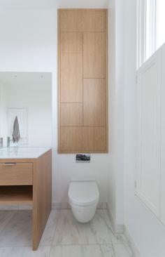oak veneered bathroom cabinet with push to open doors.