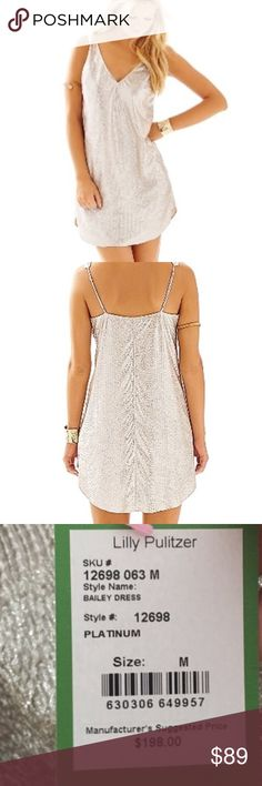 """Lilly Pulitzer Bailey Platinum Lame V-Neck Dress M BAILEY LAMÉ V-NECK DRESS  DESCRIPTION  This is not your mother's lamê. She tested it, but now you can perfect it. Outshine the crowd with this metallic dress, updated for your next special occasion. ATTENTION: eyes will only be on you.  V- Dress With Shirt-Tail Hem And Pockets. 20"""" From Natural Waist To Hem. Crinkle Lamê (100% Polyester). Lined. Hand Wash Cold. Imported.  Style #: 12698 Lilly Pulitzer Dresses"""