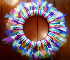 Tulle wrapped wreath WILD BRIGHT COLORS, then add some chunky braids!WreathartDesign shared a new photo on Etsy Christmas Mesh Wreaths, Easter Wreaths, Deco Mesh Wreaths, Burlap Wreaths, Door Wreaths, Spring Wreaths, Yarn Wreaths, Floral Wreaths, Summer Wreath