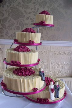 Rose red wedding cake -- minus the pink. This reminds me of what you were talking about with the different cakes and flavors. @Brittany Webb