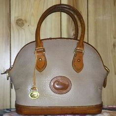 Taupe Norwalk in good condition Inside needs a good cleaning. Outside is in good shape. Has much life in her. Dooney & Bourke Bags Satchels