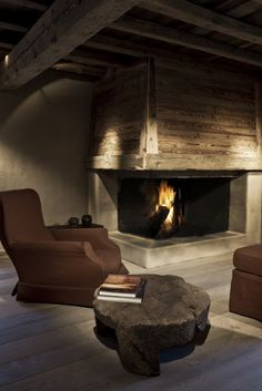 Beams, reclaimed wood, stone fireplace - would be great for a basement man cave
