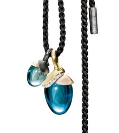 Ole Lynggaard Copenhagen Lotus Pendants (small & large) Blue Topaz cabochon drops in silver and 18ct yellow and rose gold - Kennedy Jewellers