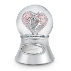 """<strong><font color=""""#8e0c3a"""">♫ Plays """"Pachelbel's                        Canon""""</font></strong><br/>There's no better way to say, """"I love you,"""" than     with a beautiful, personalized snow globe from Things Remembered. She'll be     dazzled as the pink filigree heart twirls through glistening water. Personalize it with her name, and it becomes a keepsake she'll cherish for                  years.<br><br>-The perfect personalized birthday gift"""