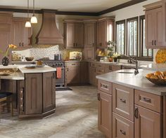 Careful choices make a lasting difference. A sophisticated finish, such as Riverbed, brings elegance to this kitchen with Cherry cabinets and suits a variety of elements, from range hoods to mouldings. Rely on the subtlety of detail for a look that is easy to love.