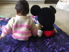 Baby and Mickey Mouse.  Baby with toys Photography