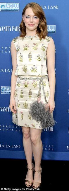Spring style: Emma, 28, wore a simple yet stylish two-piece dotted with floral plant designs. She wore a silver filigree belt slung low on her hips that featured fluffy gray tassels on the ends