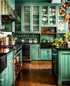 Check out this unusual kitchen design with green eclectic cabinets. Love it! #KitchenDecor #KitchenDesign #HomeDecorIdeas @istandarddesign