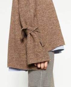 Knit tied sleeves