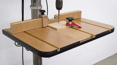 The built-in tables that come on most drill presses are a bit undersized for woodworking and they lack a fence to help with drilling repetitive holes down a piece of.