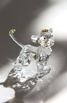 Swarovski Crystal Disney Collection, The Lion King, Simba by Swarovski Crystal, http://www.amazon.com/gp/product/B005ED1XL8/ref=cm_sw_r_pi_alp_kGL1qb19WTCAS