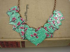 9 Heart Necklace, Double-sided and Embossed  Recycled Soda Can Art using an Arizona Tea can. $17.95 on ETSY.