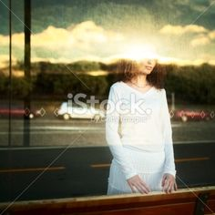 reflection of young woman in the city