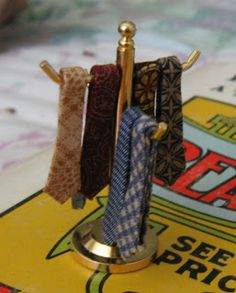 Pattern technique for DIY miniature men's folded ties plus this presentation great for display
