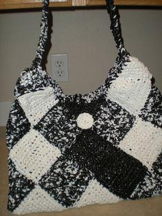 Black and White - Plarn Purse -  yep, plastic yarn. No pattern but she's got cute ideas
