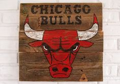 This sign features the Chicago Bulls logo hand-painted on reclaimed wood by VintageSignDesigns.