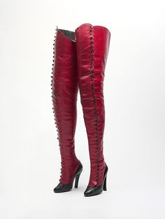 """1900-1920 Sexy, leather and cellulose, tall, button boots from Paris. Labeled - """"Maniatis/Bottier/36 rue de Belle Ford/Paris (9e)/Tel. Taudine 43-57"""".  Here is another pair of what looks like early 1900 fetish wear.  Something tells me a spinster did not own these. - grins.  My guess is a performer or """"naughty"""" girl did. See them at http://www.metmuseum.org/Collections/search-the-collections/80073912#"""