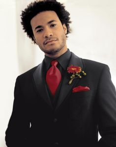 Groom | Don't like the flower... but I do like the black suit vest and shirt, with the red tie and hanky