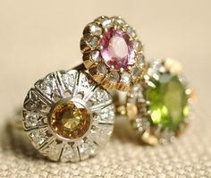 Yellow sapphire, diamond, 14k white gold ring, ca. 1925 | Pink spinel and rose cut diamonds, 14k rose gold ring, ca. 1845 | Peridot and diamond ring, ca. 1930