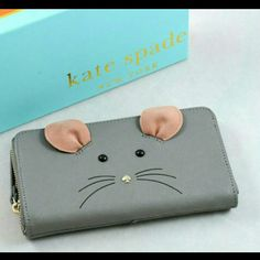 Kate Spade The Cat's meow Mouse Lacey wallet NIB never used,  but my daughter removed the tags before gifting it to me.  Kate Spade The Cats Meow Mouse Lacey Continental Zip around wallet.   Impossible to find!   No lowball offers!  Will ship in 5-7 days.  Check out my closet, Erin's Discount Depo on Mercari for discounted prices! Price is high on here because of Poshmark's fees kate spade Bags Wallets