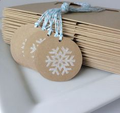 Christmas gifts tags, Kraft with stamped snowflake in white.