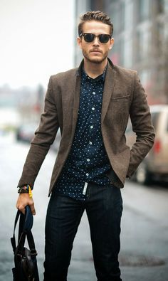 Shop this look for $275:  http://lookastic.com/men/looks/black-jeans-and-dark-brown-tote-bag-and-navy-longsleeve-shirt-and-brown-blazer/3564  — Black Jeans  — Dark Brown Leather Tote  — Navy Polka Dot Longsleeve Shirt  — Brown Wool Blazer