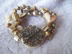 Beautiful Vintage Retro Bead Stretch Bracelet with Medallion Center Piece