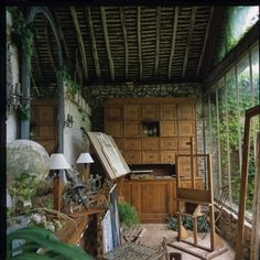 Perfect garden shed! Love the rustic, run-down feel of it.