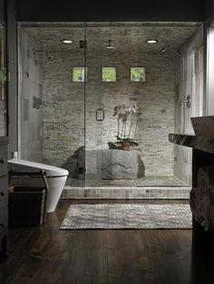 Contemporary Master Bathroom with Dual shower heads, Rain Shower Head, Inline Door and Panels, Stone Tile, Hardwood floors
