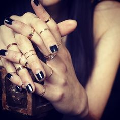 dark moon manicure + little stacked rings.