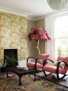 Matthew Williamson presents a collection of exotic fabrics and co-ordinating wallpapers inspired by an island paradise. A home made beautiful with Matthew Williamson's Bird of Paradise wallpaper in lemon yellow. The wallpaper is complimented with pink chairs and a pink ostrich feather lamp.