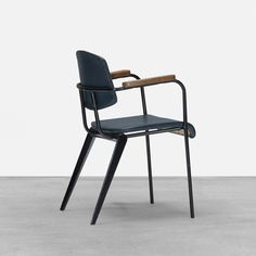 Jean Prouvé; #355 Enameled Steel and Oak Conference Armchair, c1953.