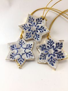 Three Blue and White Stoneflake Ornaments with Gold Edging image 0 Clay Ornaments, Snowflake Ornaments, How To Make Ornaments, Holiday Ornaments, Snowflakes, Ceramic Christmas Decorations, Christmas Crafts To Make, Polymer Clay Christmas, Paperclay
