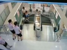 Video grab from security footage of a woman and child involved in an escalator accident in Jingzhou City, Hubei Province, Central China, July 26, 2015.