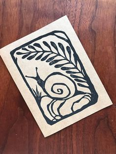 This lovely image of a snail taking a bit of shade under a fern frond is an original linoleum block printed design. Printed on a natural brown card, its ready for your happy message inside Stamp Printing, Screen Printing, Lino Art, Snail Art, Linoleum Block Printing, Stamp Carving, Linoprint, Artwork Images, Linocut Prints