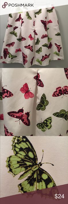 "Talbots Skirt This Talbots Woman's skirt is pretty! Size 14W. Plus size. Waist 33"".  Side elastic at waist. Below knee length at 24.5"". The creamy white skirt has a slight texture, and a butterfly print, in pinks and green, outlined in black. The skirt zips on the side, is flared, and has inverted pleats, which open up at 9"" down the skirt. Fully lined. Great pre-owned condition. Wonderful! Talbots Skirts Midi"